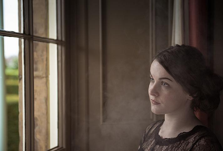 Woman window jeztimms/unsplash 6