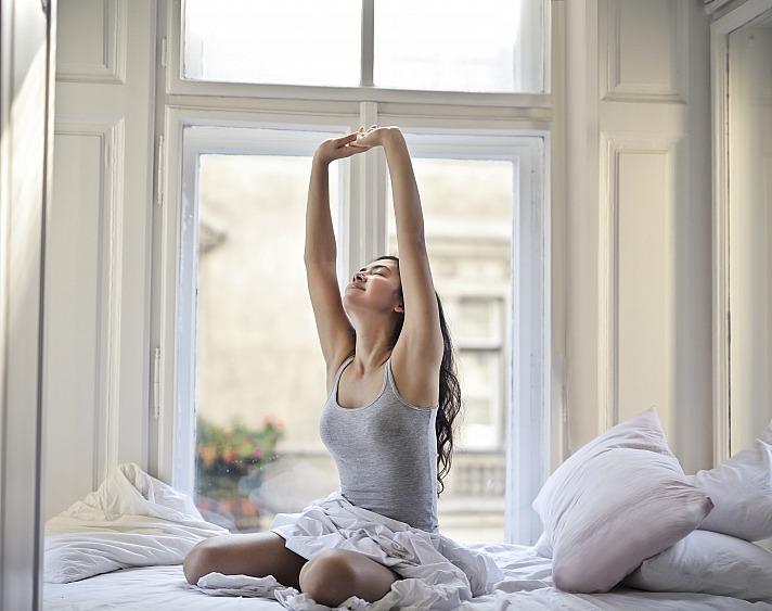 Woman bed stretch brucemars/unsplash 1